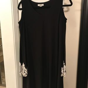 Little black dress with lace belle sleeves